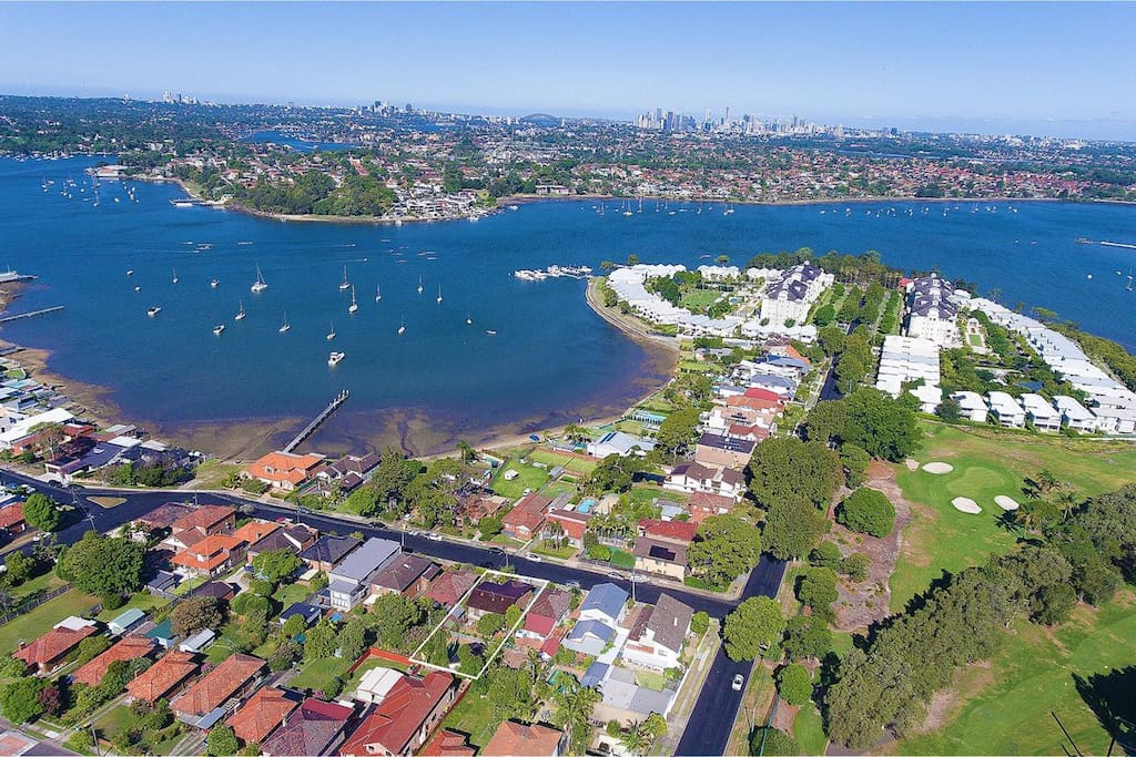 Surrounded by the water, prestigious neighborhood and the nearby golf court is this home.