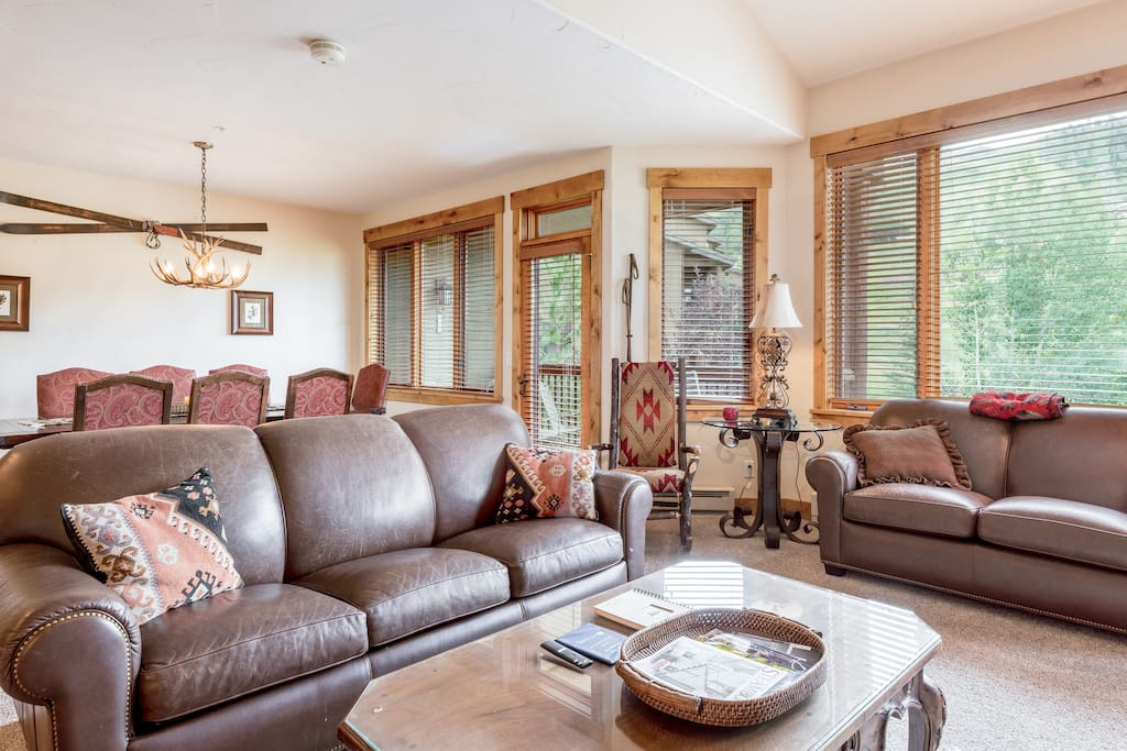 In the living room, guests can sink into a leather love seat, sleeper sofa, or the cushioned rocker.