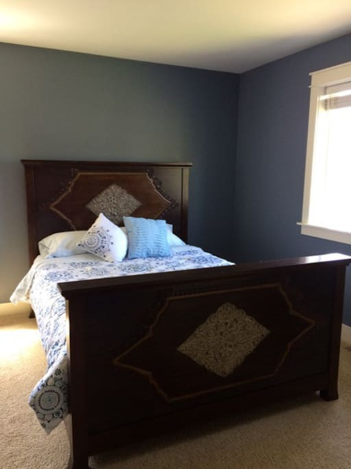 The master bedroom, with Queen bed, full bath, walk-in closet and additional bonus room.