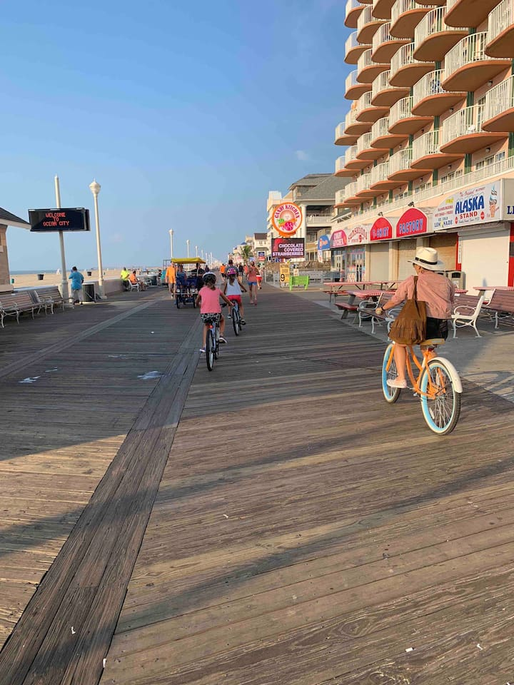 Start of the boardwalk, two blocks away. Easy walk,  we love to ride our bike in the am, or take the tram down to the end to eat some Thrasher fries, Dumser's ice cream and pay arcade games.