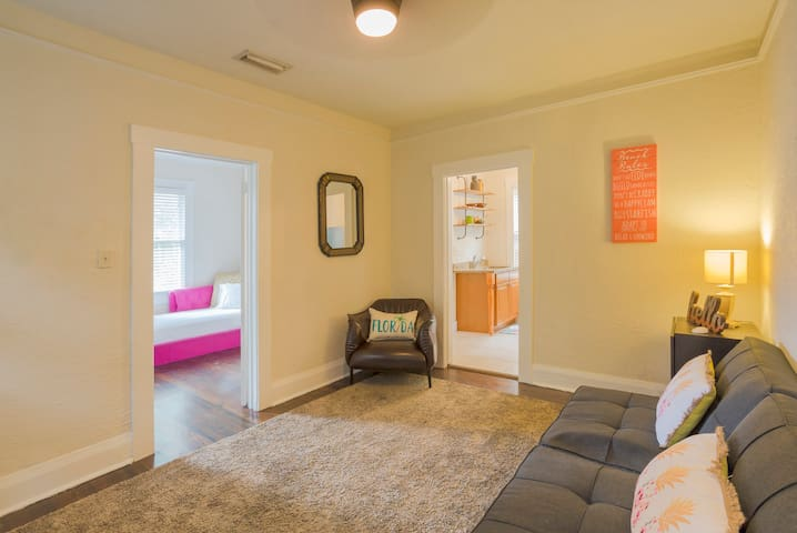 Living room includes comfy leather chair, futon that converts into single sleeper, and BRAND NEW 43-inch flat screen smart tv