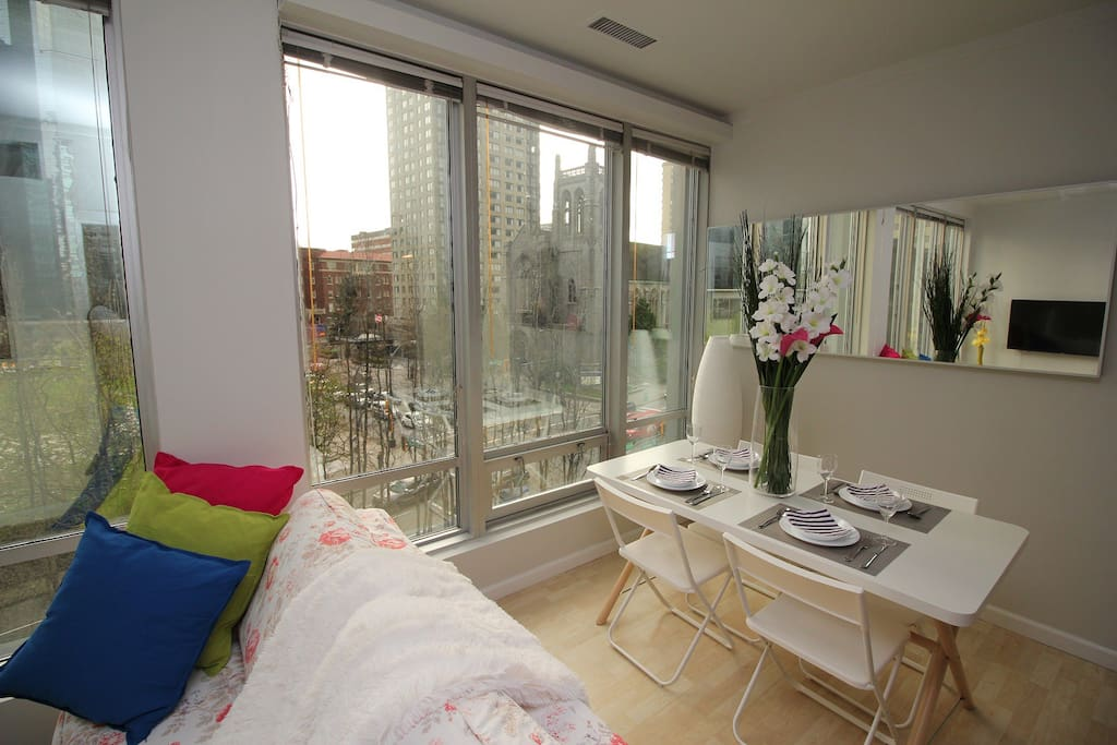 Large windows with a spectacular view of downtown Vancouver