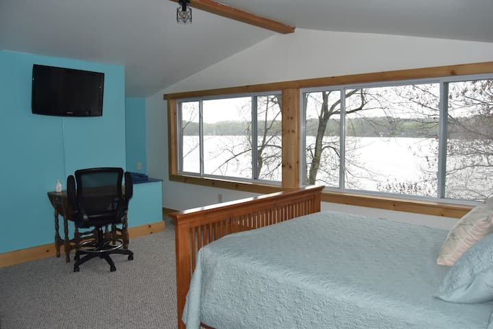Master bedroom overlooking lake.  Hear the loons from your queen bed!