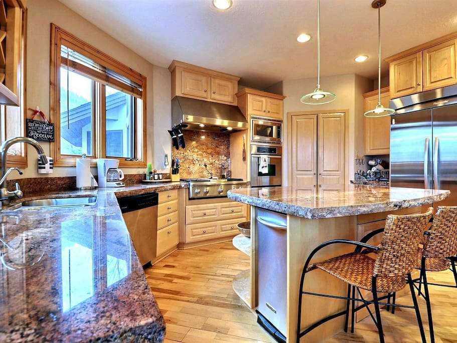 Remodeled Kitchen with Granite Counter-tops and Stainless Steel Appliances