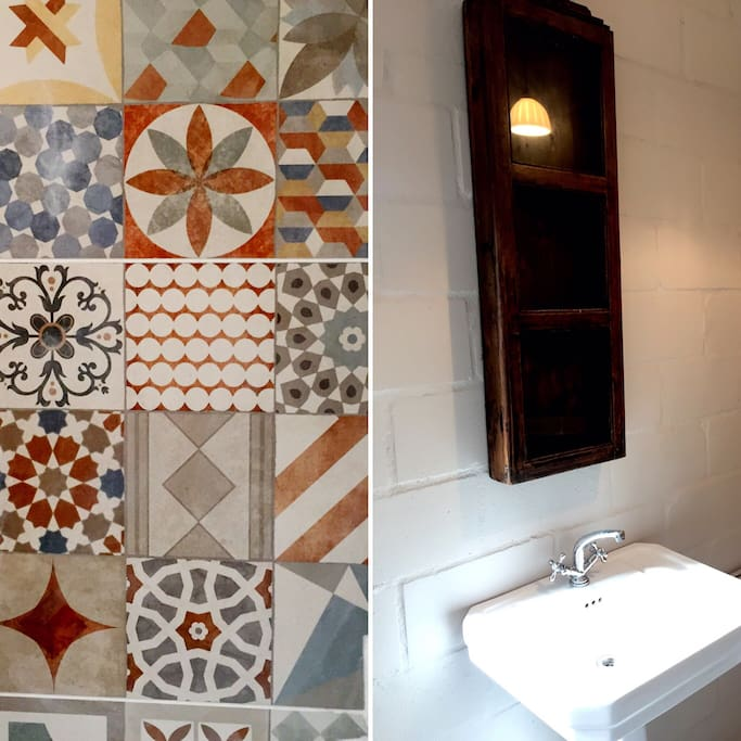 Moroccan mosaic tiles shower and WC cubicle. Victorian basin in main cottage area.