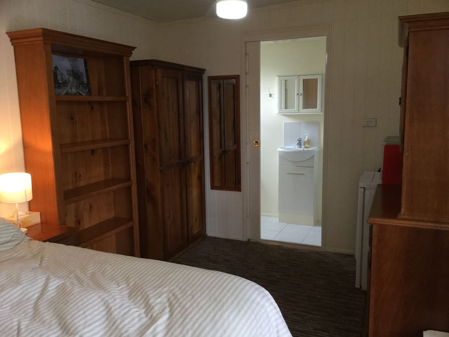 View towards ensuite, full length wardrobe and bookcase, heaps of other storage available for those with luggage or staying a bit longer