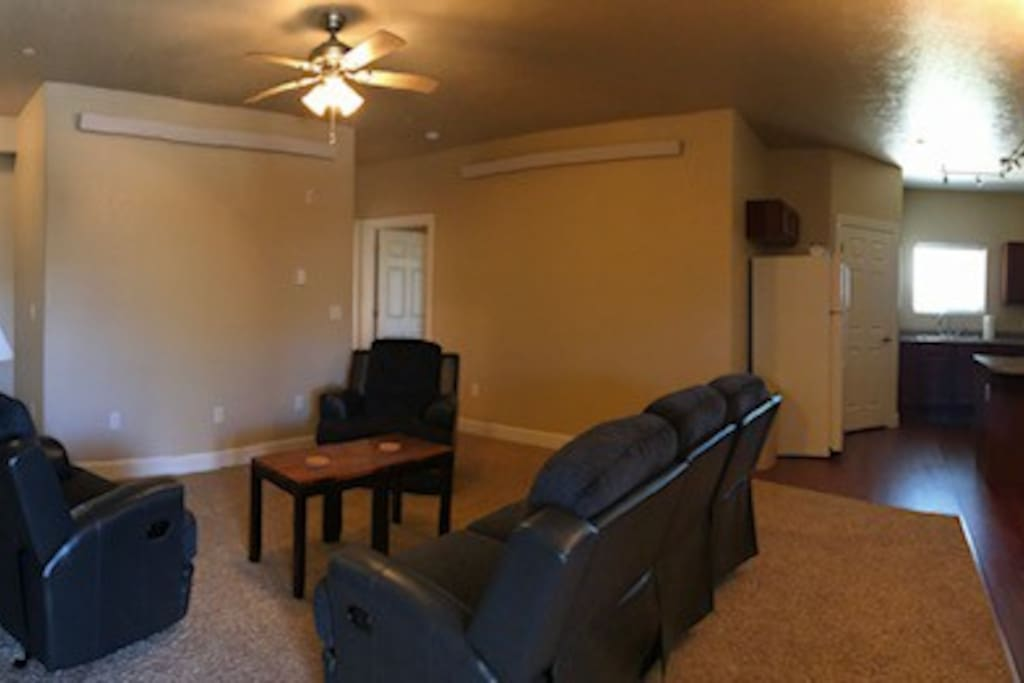 This is the living room, a TV has been mounted on the wall.