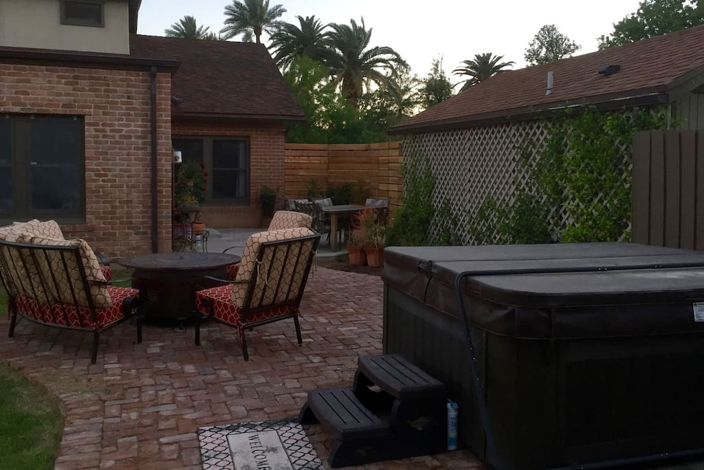 Outdoor space for relaxing, with hot tub and fire pit.