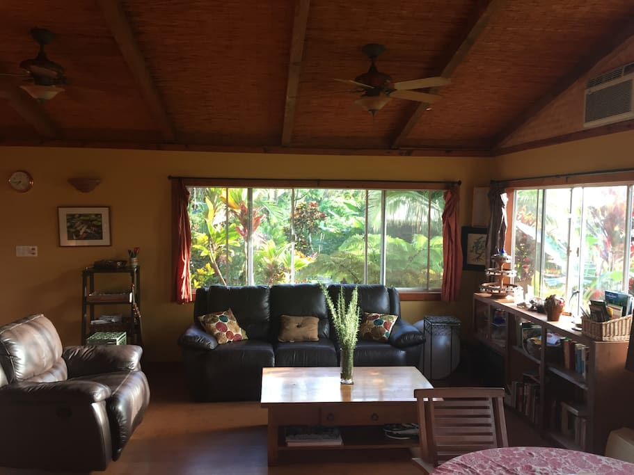 Family room with cozy leather recliner couch and chair