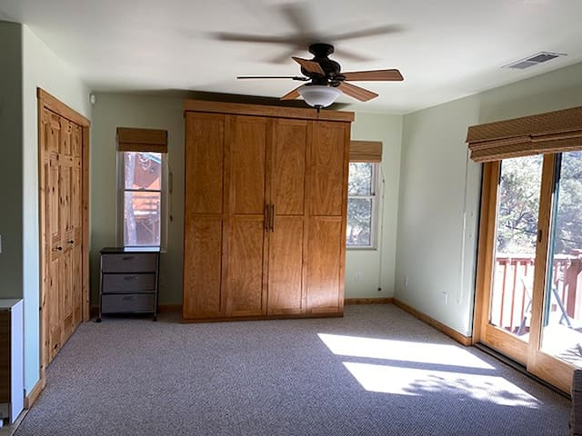 Murphy bed closed.  Just open the cabinet doors and pull down the hydraulic bed softly lowers and rises.  Metal frame with a queen size mattress.