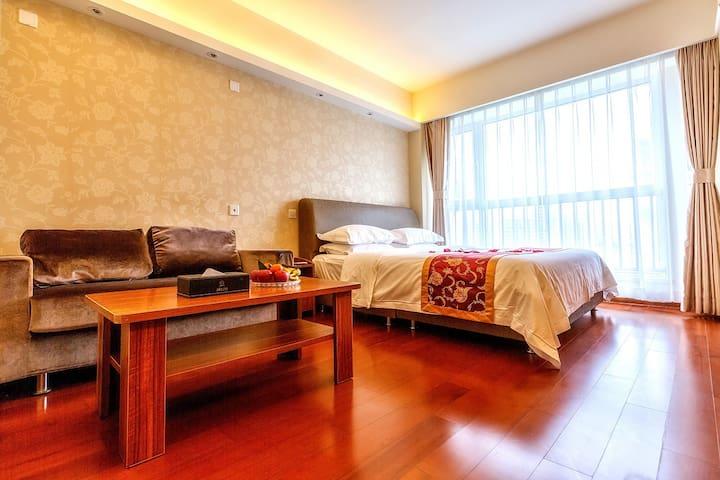 青岛深蓝假日度假式公寓--豪华商务大床房 - Qingdao - Apartment