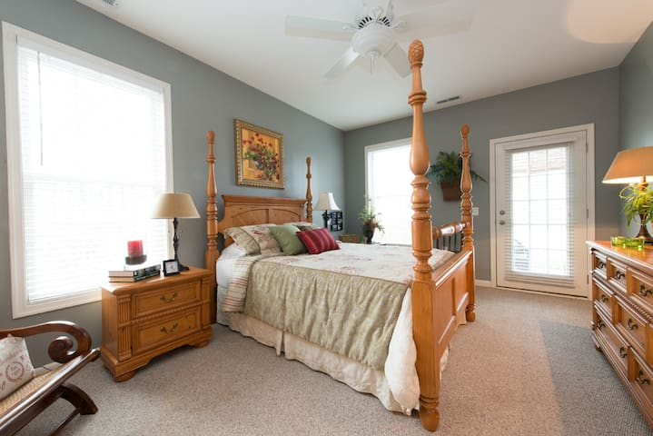 Master bedroom opens out to the screened in porch all which overlook a lovely pond. It's great at night to sleep with the door open and hear the fountain!