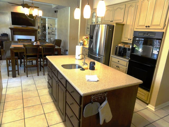 Also in the open concept kitchen you'll find double ovens, a microwave and refrigerator.