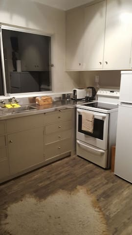Kitchen also has views to boat harbour, lake and mountain. Fully equipped kitchen.