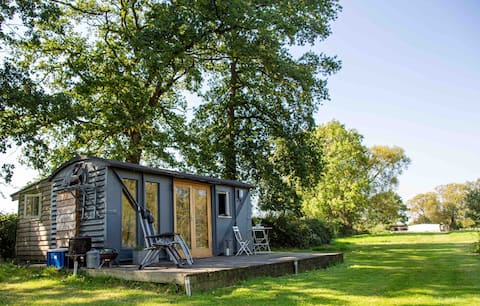 Cosy converted railway wagon by lake