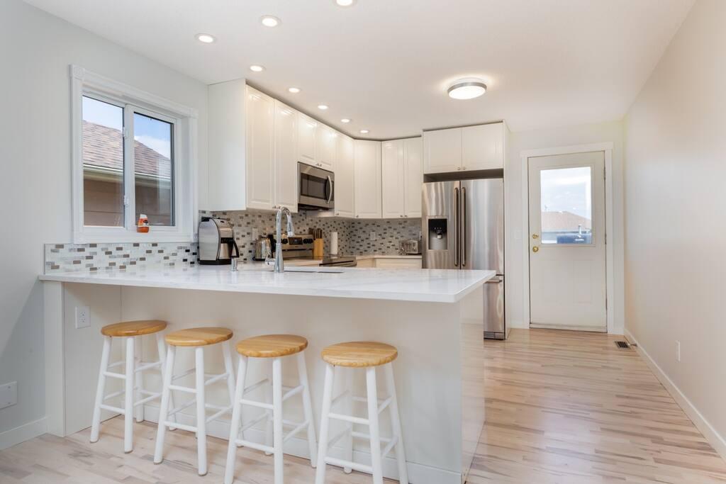 Renovated kitchen with quartz countertops