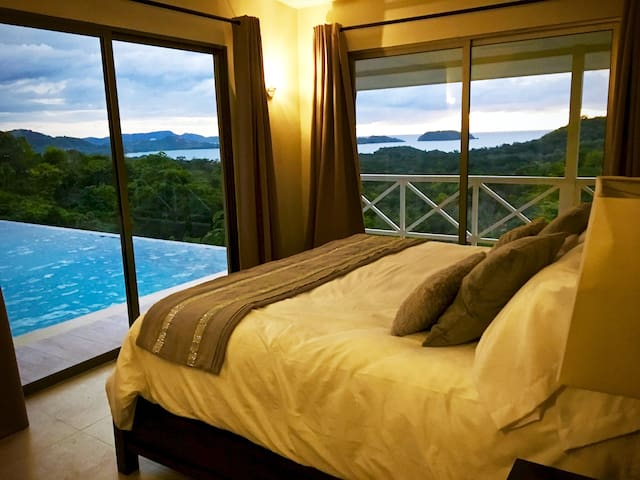 Master Spacious bedroom with king size bed and private ocean view balcony