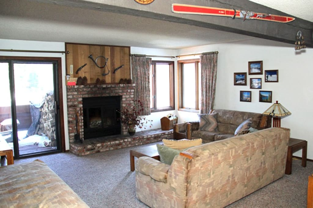 Mammoth Condo Rental Sunrise 46 - Living Room has a Fireplace and Outside Deck