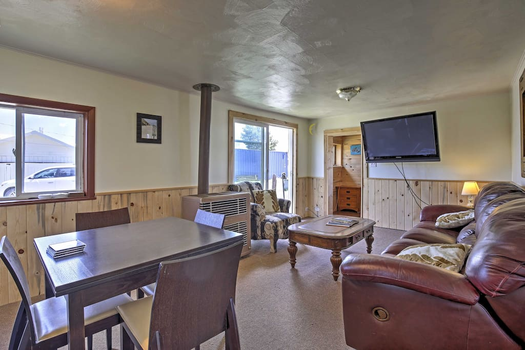 Inside, the home is completely furnished with everything you need for your getaway, including comfy couches and a large flat-screen cable TV.