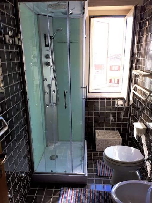 bathroom with a spacious shower box