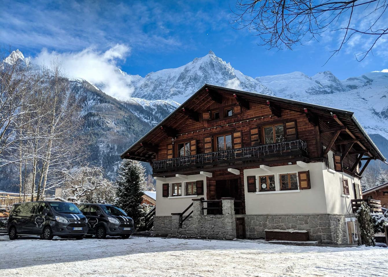 Chalet 715 in Winter with client minibuses for in-resort transfers