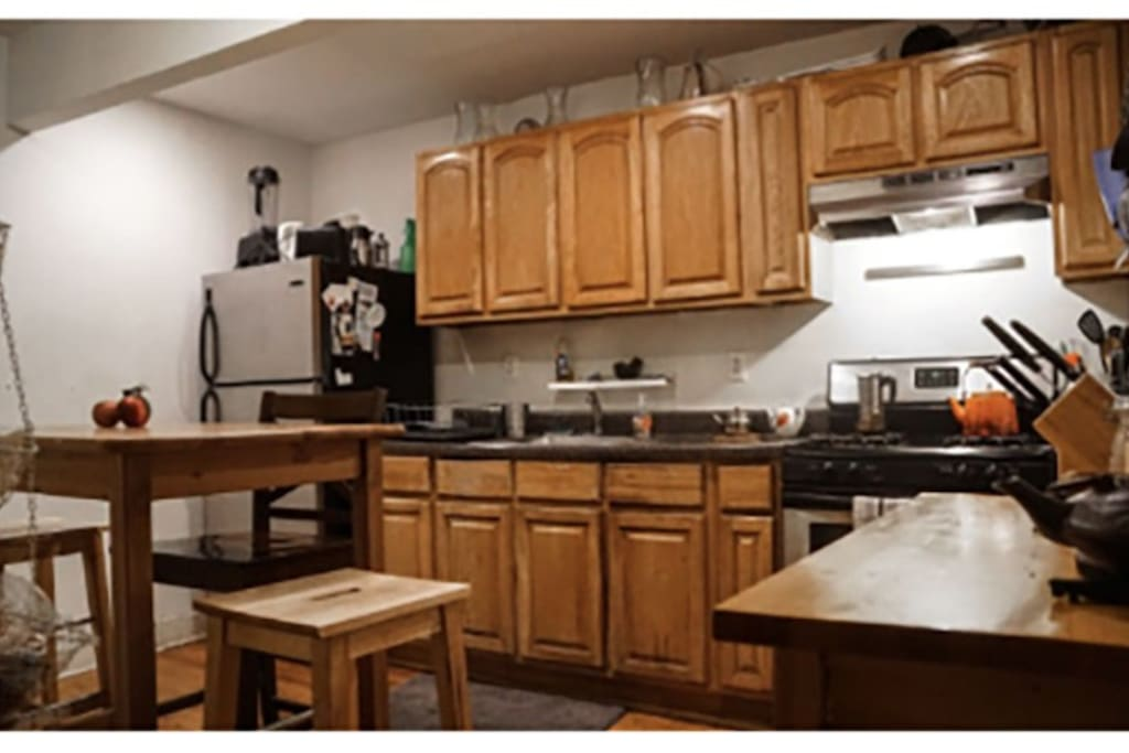 Shared kitchen, spacious and convenient, furnished with microwave oven and all necessities.