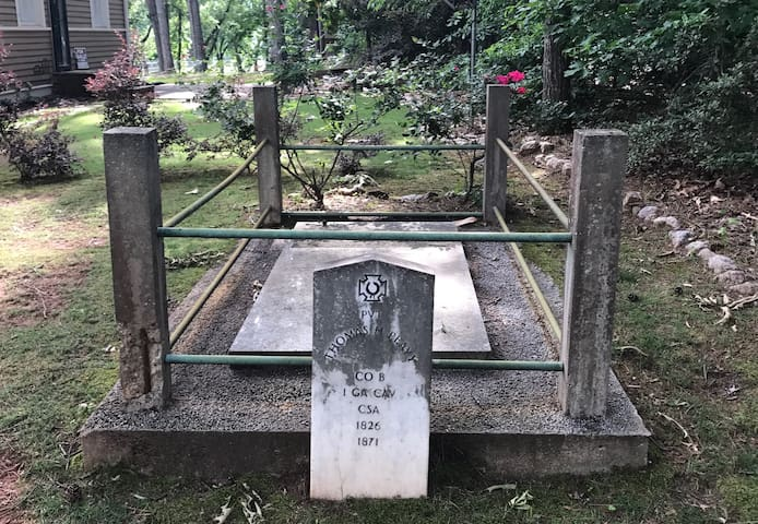 The grave of a civil war soldier sits in the side yard.
