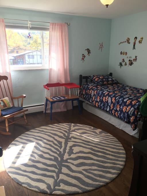Twin bedroom with additional twin mattress under the bed.