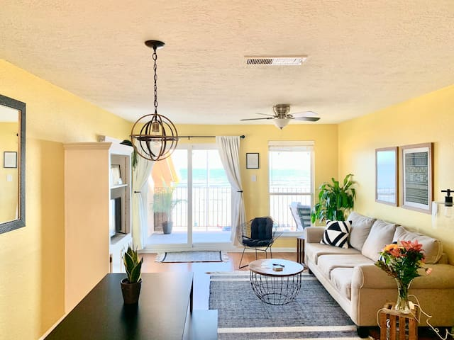 Enjoy the natural light and ocean view from the kitchen and spacious living room! Top floor view!