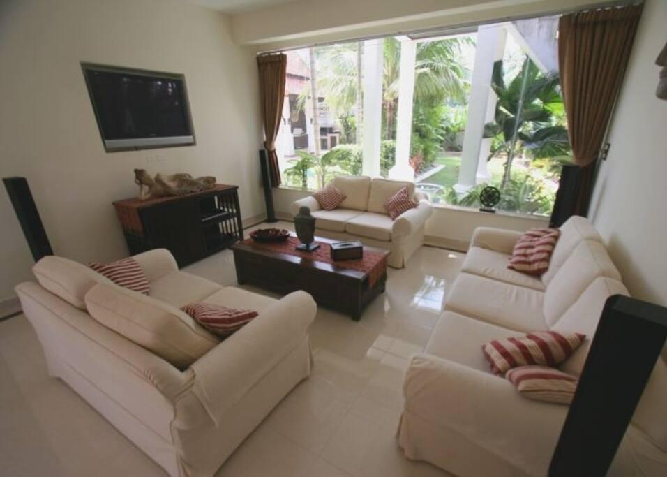 White sofa and flatscreen TV