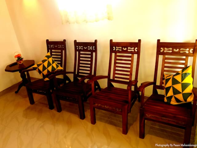Living room with one wooden table, 4 chairs with pillows