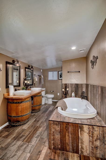 Over-sized bathtub with shower and oak barrel vanity