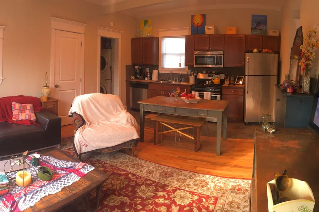Living room, kitchen and utility space with washer and dry
