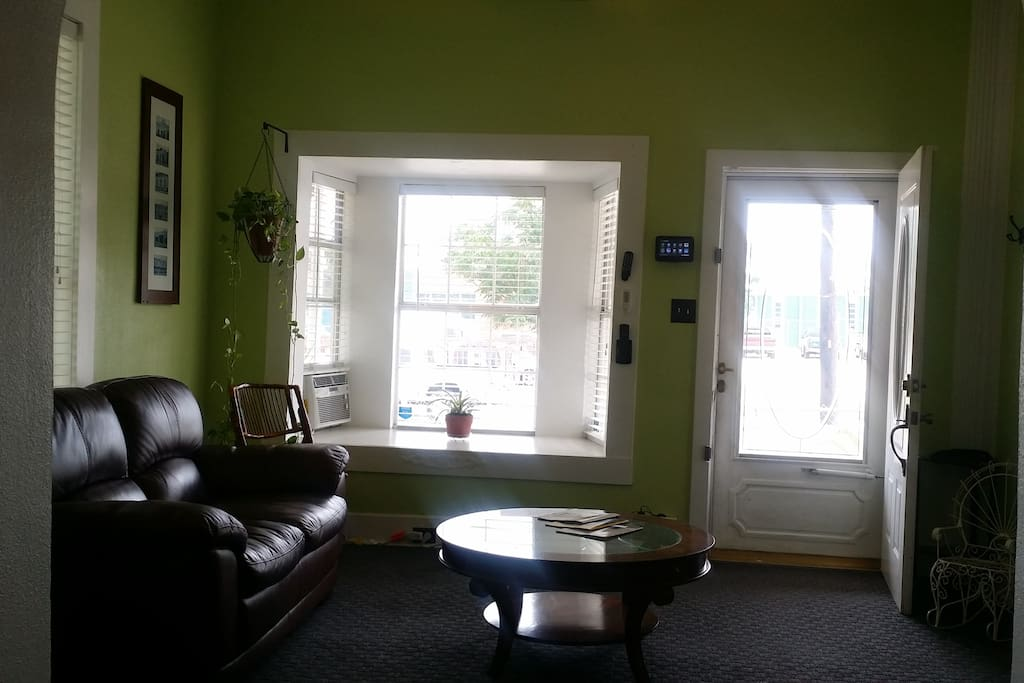 Front room with bay window and entrance to house.