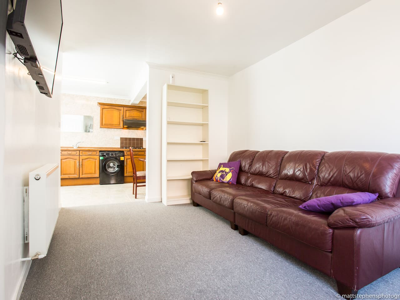 Spacious lounge with a comfortable sofa to relax after a day of exploring Brighton
