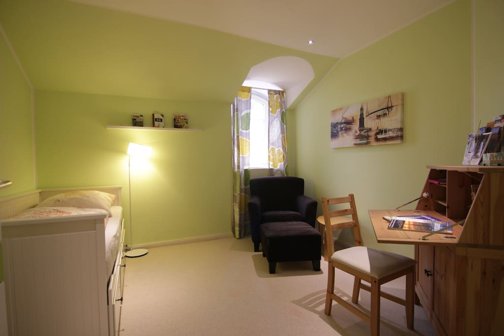 Our comfortable room has enough space for 1-2 peple, with comfortable single couch and a writing table for checking out Hamburg travel information!