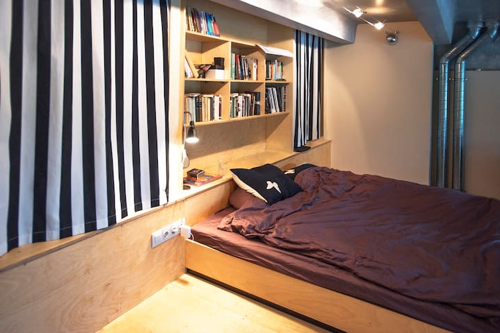 King size bed in the second floor of the loft.