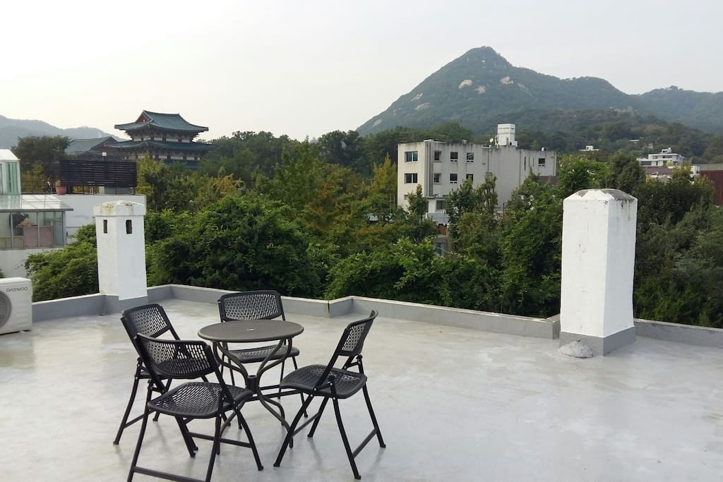 the view of our guesthouse(at the rooftop and the 2nd floor's treeace)