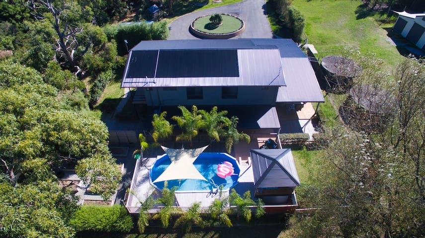 Aerial view of house and pool