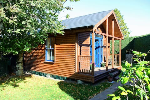 Spacious Log Cabin set in Tranquil Gardens