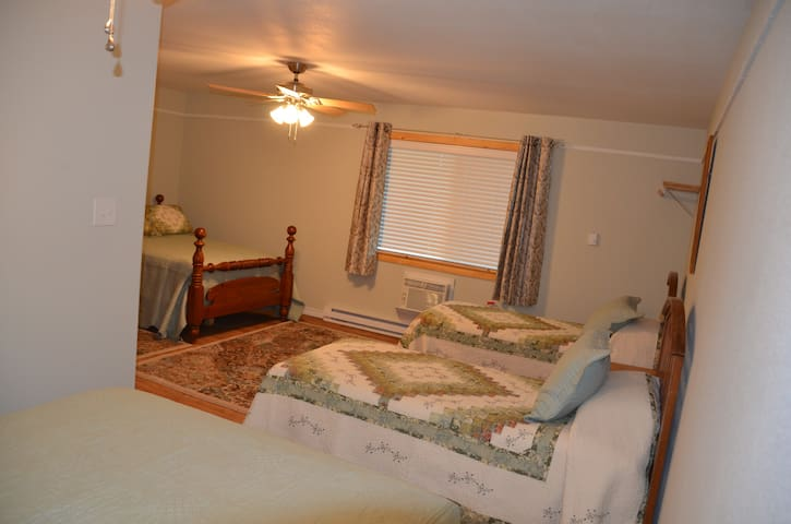 Four separate beds in spacious separate bedroom