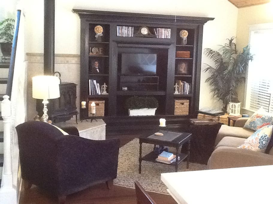 Living room with boards games and movies.