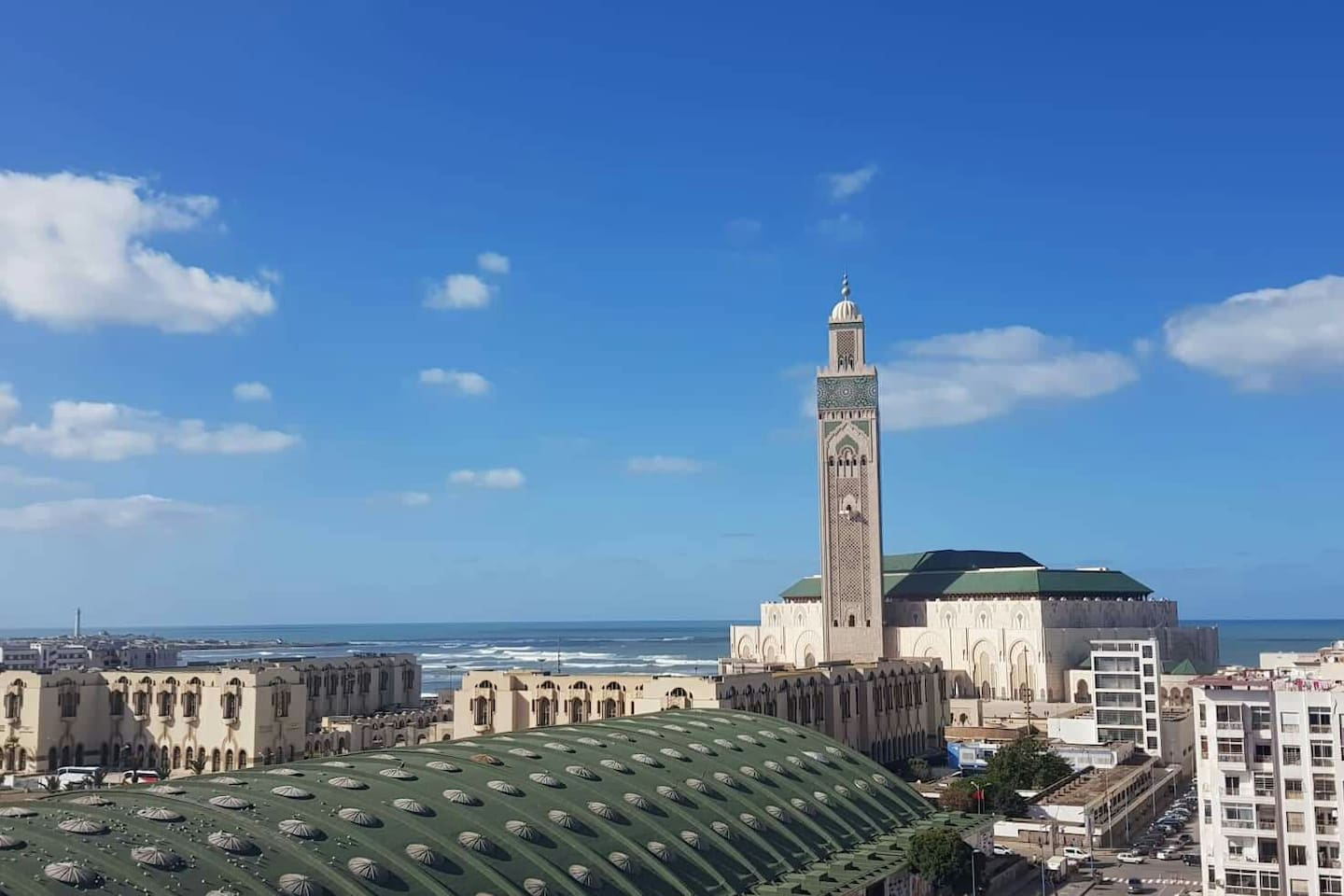 A panoramic view of the Hassan ll Mosque compound with the Atlantic Ocean in the back ground visible from the balcony and guest rooms