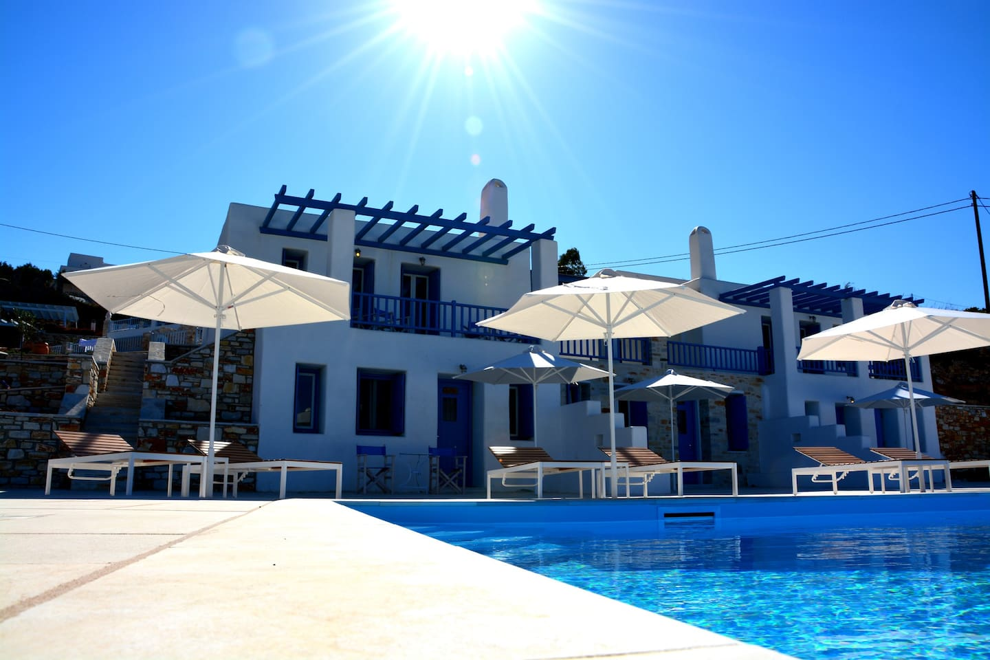 """The house named """"Chrissi Akti"""" has its own balcony with Sea View, Parking and aveliable sun loungers and shady umbrellas near the pool."""