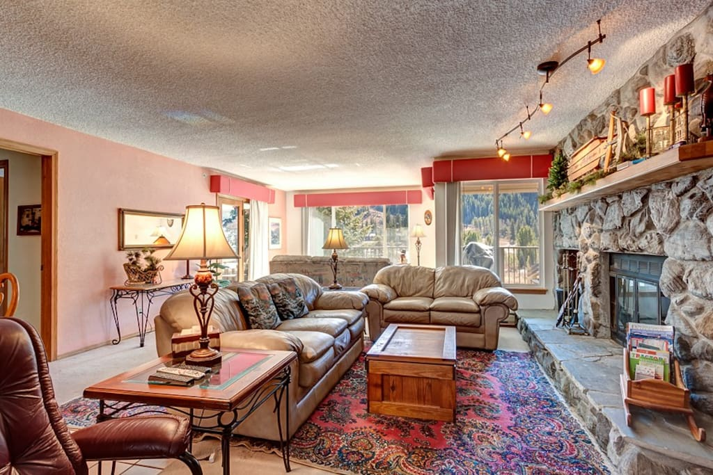 Main living space, sectional seats 7 plus recliner, TV/fireplace. Rustic Mountain decor throughout.