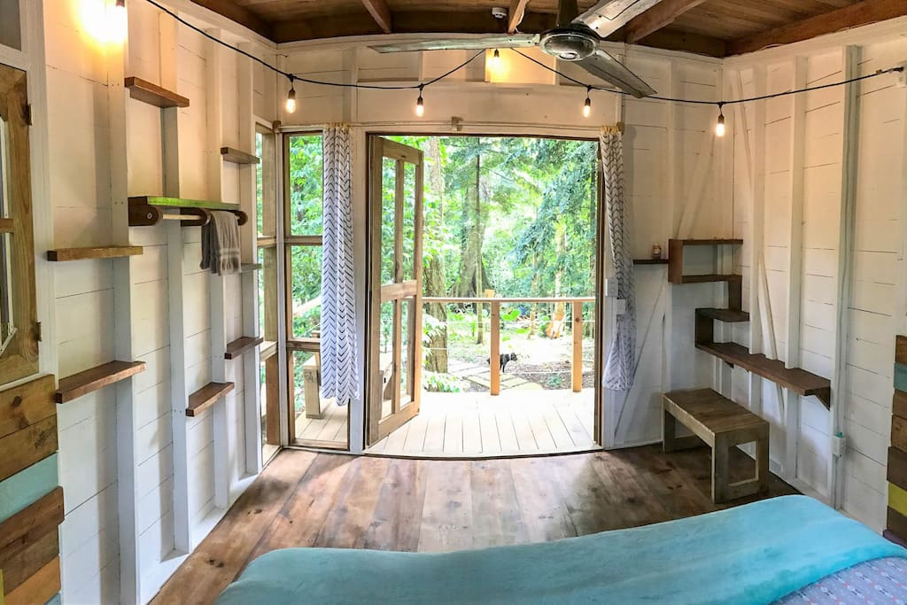 Giant french doors opening out to your porch 15 feet in the trees.