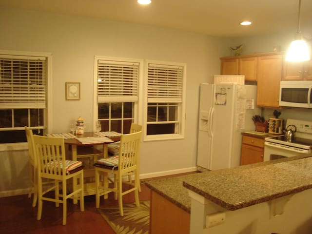 Fully stocked kitchen with breakfast nook that seats 4 more.