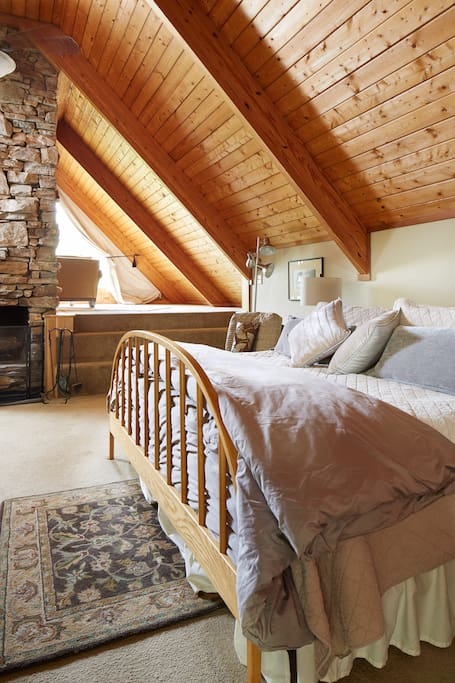 Stone fireplace & King size bed