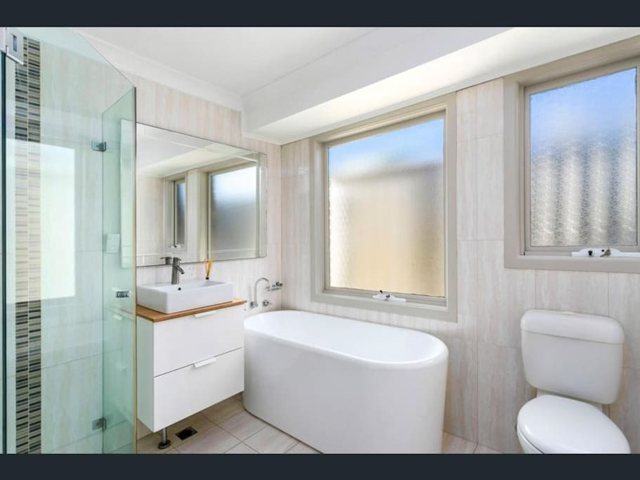 Main bathroom with separate outdoor laundry and toilet