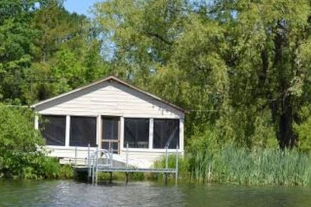 Close to the waterfront with a screen in porch overlooking Cedar Lake with the Monkton Ridge in the background.